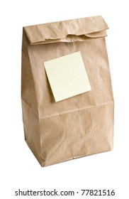 Lunch bag with empty post note on it.