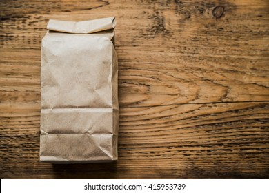 Lunch bag isolated on wooden texture background ot kitchen table.