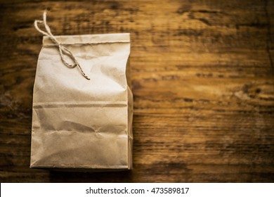 Lunch bag isolated on wooden texture background ot kitchen table. empty space for inscription or other objects