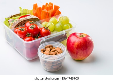 Lunch box with fresh vegetables and fruits.