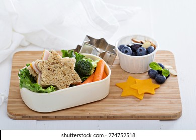 Lunch box with sandwich, carrots and salad