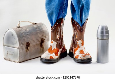 Lunch box for school with young boy in cowboy boots.