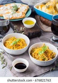 Lunch with curry pasta noodles in bowls and vegetables with turmeric