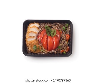 Lunch delivery. Noodles with chicken and vegetables for healthy nutrition in to go box on white background, copy space