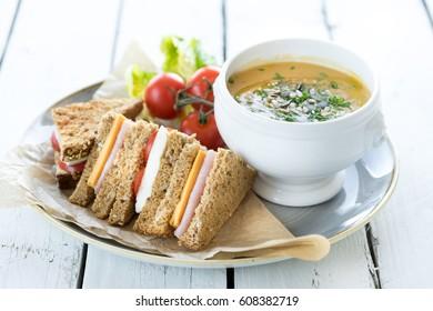 lunch dinner plate fresh cut sandwich ham cheese cup bowl vegetable creamy soup garnish seeds