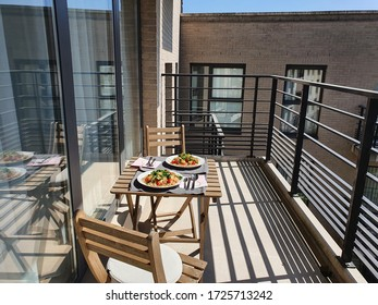 The lunch is eaten on the balcony during isolation