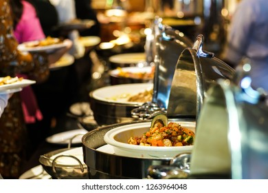 Lunch food buffet catering party with hand of people enjoying food serve
