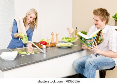 Lunch happy couple cook salad woman wash lettuce
