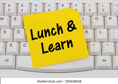 Lunch and Learn, Computer Keyboard with a yellow blank sticky note with text Lunch and Learn