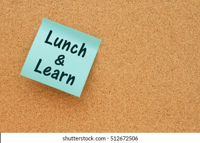 Lunch and learn notice, Bulletin board with a blue sticky note with text Lunch & Learn