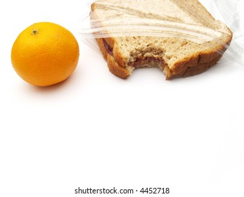 a lunch on the go - orange and peanut butter and jelly sandwich