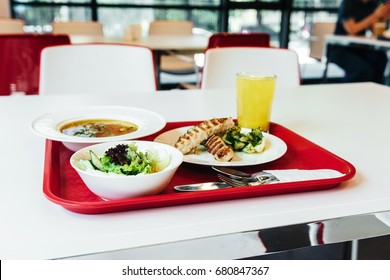 Lunch on tray in the cafeteria. Soup, salad and fried meet