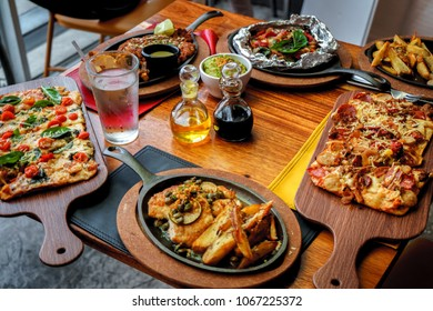 Lunch served with variety of italian dishes on a wooden table for restaurant background.
