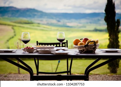 lunch with a view - table against beautiful landscape in Tuscany