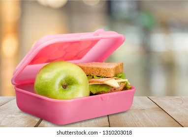Lunchbox with an apple isolated on background