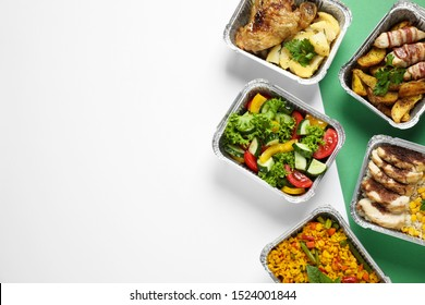Lunchboxes on color table, flat lay. Healthy food delivery
