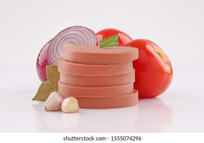 luncheon canned meat cuts, cold cuts, slices with vegetables on white background - Shutterstock ID 1555074296