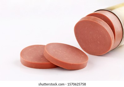 luncheon Lanshon Mortadella meat slice cut knife isolated on white background - Shutterstock ID 1570625758