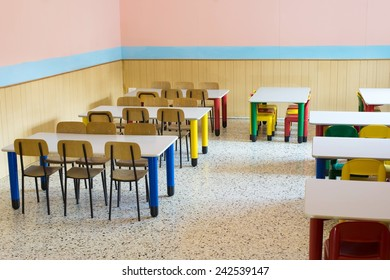 lunchroom of the refectory of the kindergarten with small benches and small colored chairs