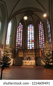 Luneburg, Germany - 10.12.2017: Christmas altar in catholic church and stained glass behind it