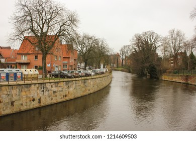 Luneburg, Germany - 10.12.2017: Medieval traditional European houses and Ilmenau river. Winter in the Europe