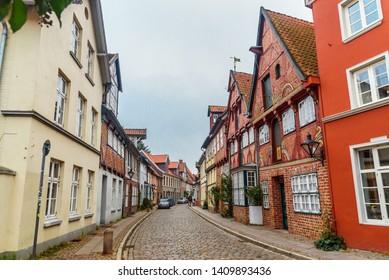Luneburg, Germany - November 04, 2018: Street with Medieval old brick buildings in Luneburg