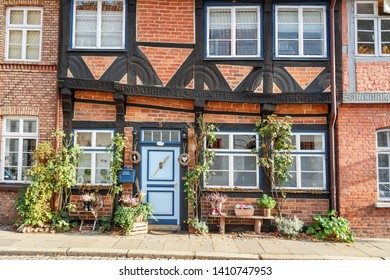 Luneburg, Germany - November 04, 2018: Medieval old brick building decorated by plants in Luneburg