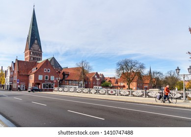 Luneburg, Germany - November 06, 2018: View of Cathedral and old historical houses from bridge over Ilmenau river in Luneburg