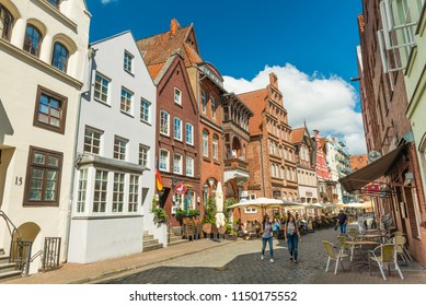 Luneburg (Lüneburg) - July 2018, Germany: Old historical houses in one of the streets of the famous German town. Traditional architecture style, brick and painted buildings with triangle roofs