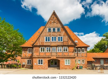 Luneburg - July 2018, Germany: Old brick half-timbered house in the traditional German architecture style. Facade of a historical building in a small European town