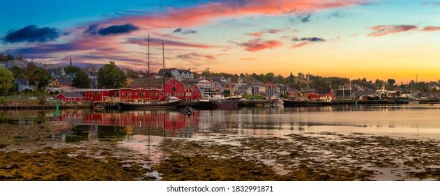 Lunenburg, Nova Scotia, Canada. Beautiful view of a historic port on the Atlantic Ocean Coast. Colorful Cloudy Sunrise Artistic Render. Panorama