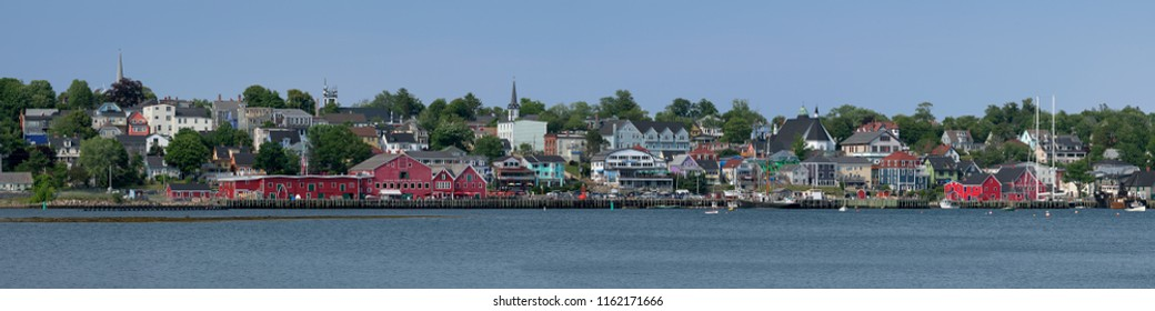 LUNENBURG, NOVA SCOTIA/CANADA - JULY 17, 2018: Waterfront cityscape of downtown Lunenburg from the other side of the harbor