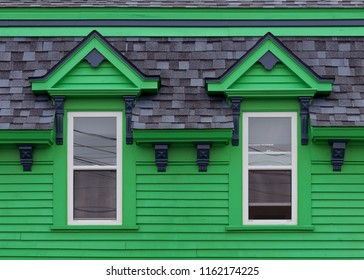 LUNENBURG, NOVA SCOTIA/CANADA - JULY 17, 2018: Two windows on framed green building on King Street in downtown Lunenburg
