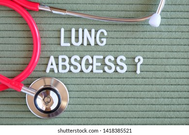 Lung abscess- text with a question mark on  green background with  stethoscope, medical concept diagnostics, treatment, healthcare.