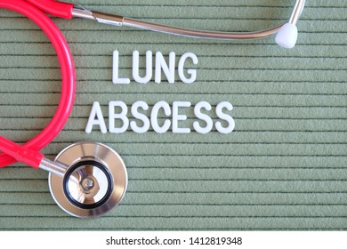 Lung abscess- text from white letters on  green background with  stethoscope, medical concept diagnostics, treatment, healthcare.