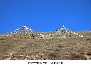 Lung ta prayer flags in western China. Tibetan prayer flags usually are  inscribed with mantras, which will be blown in the air thus spreading spirituality and goodwill in the place.