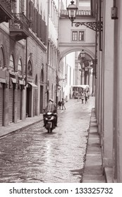 Lungarno degli Acciaiuoli Street in Florence with Motorbike Scooter, Italy in Black and White Sepia Tone