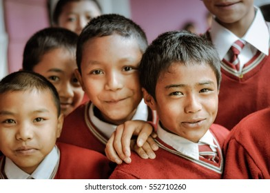 Lungdai, Mizoram - circa April 2012: Photo of young black-haired boys dressed in red school uniforms at their school in Lungdai, Mizoram. Documentary editorial.