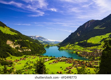 LUNGERN LAKE IN SWITZERLAND PANORAMA VIEW. MOUNTAIN LANDSCAPE WITH BLUE LAKE