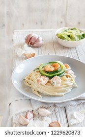 Lunguini shrimps and zucchini with cream close up