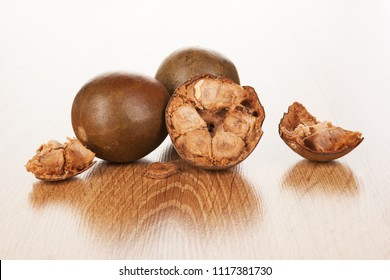 Luo Han Guo aka Monk fruit natural sweetener on wooden background. Powerful remedy.