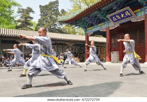 Luo Yang, China - April 22, 2011: Shaolin Monks provide a demonstration of their skills to tourists outside their training temple.