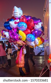 Luoyang, Henan Province / China - January 3, 2016: Woman selling helium filled balloons in Luoyang, China