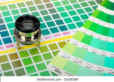 Lupe and a color guide on printed color chart (green, lime and yellow)