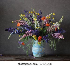 lupines and buttercups in a jar on the table. spring bouquet.