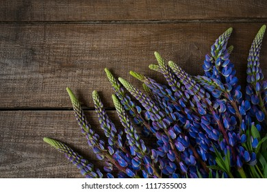 lupines on wooden surface