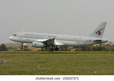 Luqa, Malta April 19, 2009: Qatar Airways Airbus A320-232 landing runway 31.