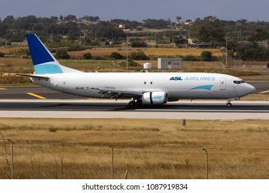 Luqa, Malta April 2018: ASL Airlines Belgium Aircraft: Boeing 737-4M0(SF) [Reg: OE-IAC] cargo plane landing runway 31.