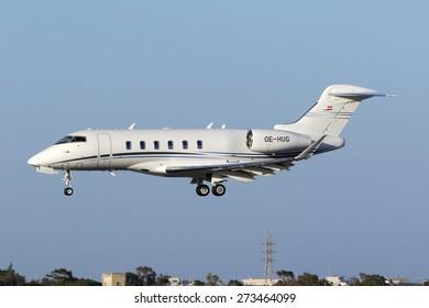 Luqa, Malta April 28, 2015: Bombardier BD-100-1A10 Challenger 350 (CL30) on short finals runway 31.