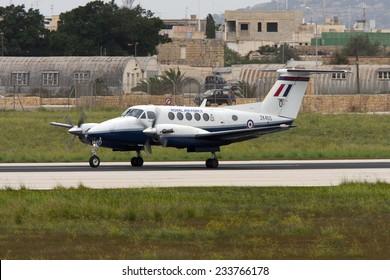 Luqa, Malta April 6, 2008: Royal Air Force Raytheon B200 King Air backtracking runway 31 for takeoff.